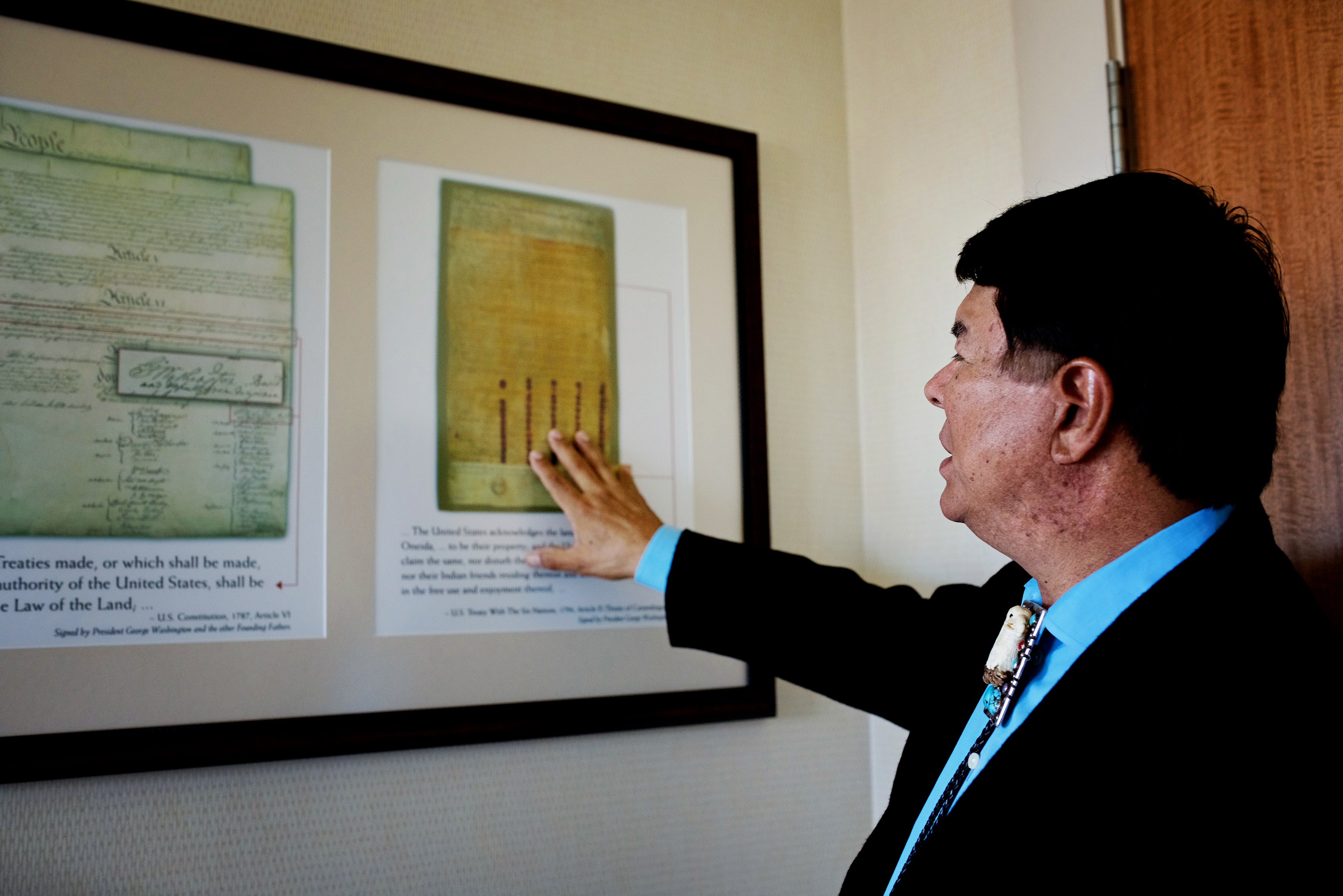 Oneida Indian Nation Representative Ray Halbritter with a framed copy of the U.S. Constitution and the 1794 Treaty of Canandaigua.